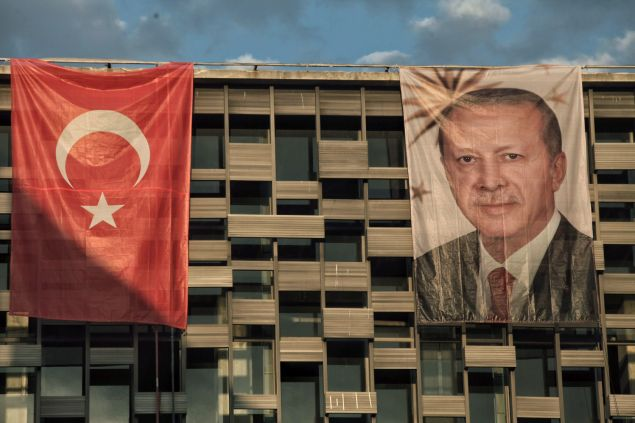 ISTANBUL, TURKEY - JULY 18: A poster of Turkey's President Recep Tayyip Erdogan hangs on Ataturk Cultural Center at Istanbul's central Taksim Square on July 18, 2016 in Istanbul, Turkey. Clean up operations are continuing in the aftermath of Friday's failed military coup attempt which claimed the lives of more than 208 people. In raids across Turkey 7,543 people have been arrested in relation to the failed coup including high-ranking soldiers and judges, Turkey's Prime Minister Binali Yildirim has said.