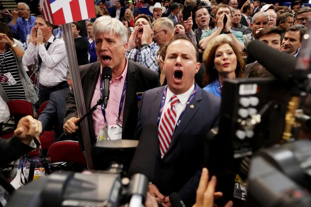 Sen. Mike Lee, center, and Phill Wright, Vice Chair of the Utah State Delegation shout 'no' to the adoption of rules without a roll call vote.