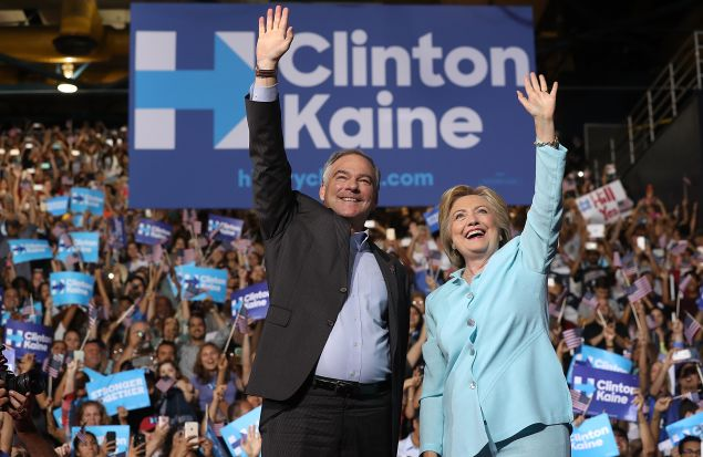 Democratic presidential candidate former Secretary of State Hillary Clinton and Democratic vice presidential candidate U.S. Sen. Tim Kaine (D-VA) greet supporters during a campaign rally at Florida International University Panther Arena on July 23, 2016 in Miami, Florida. Hillary Clinton and Tim Kaine made their first public appearance together a day after the Clinton campaign announced Senator Kaine as the Democratic vice presidential candidate.