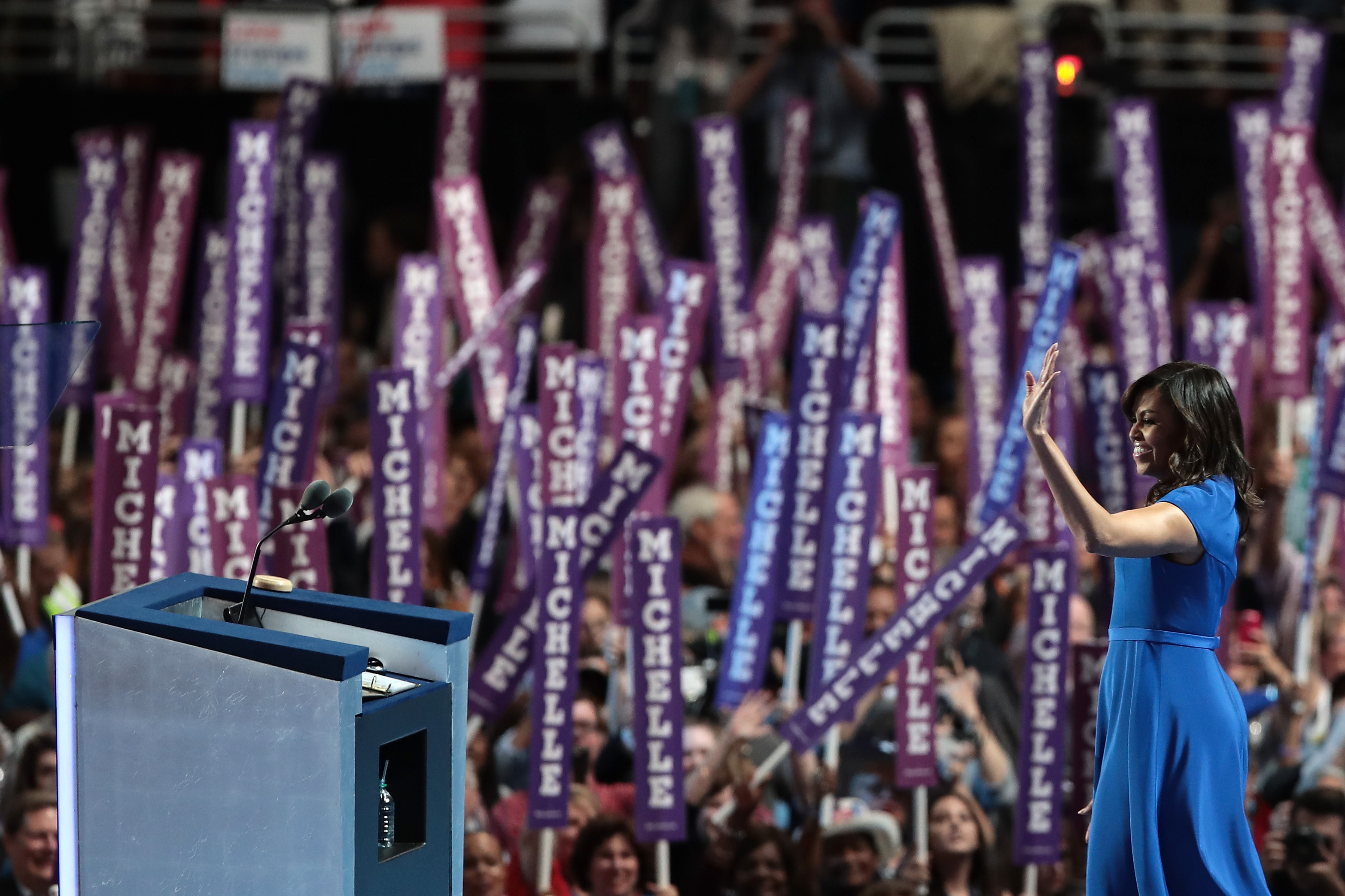 First lady Michelle Obama acknowledges the crowd after delivering remarks on the first day of the Democratic National Convention at the Wells Fargo Center, July 25, 2016 in Philadelphia, Pennsylvania.