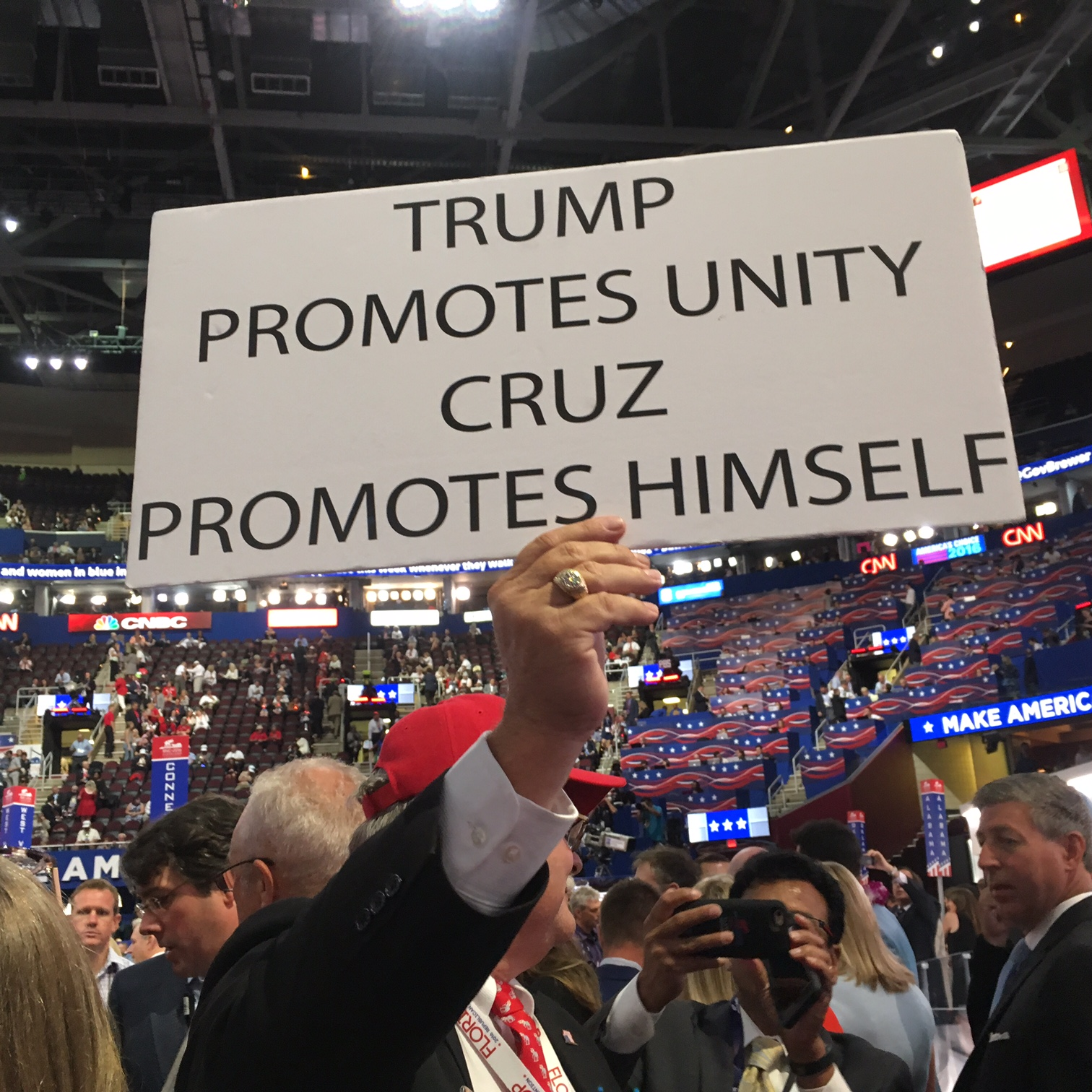 A delegate holds up an anti-Cruz sign.