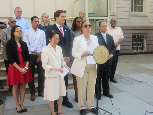 Manhattan Borough President Gale Brewer discusses a deed restriction reform proposal in front of the steps at City Hall.