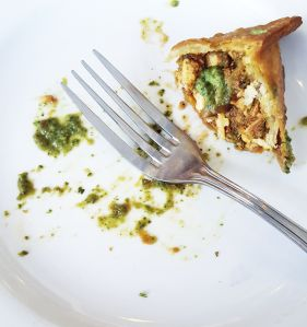 There's butter chicken inside this samosa.