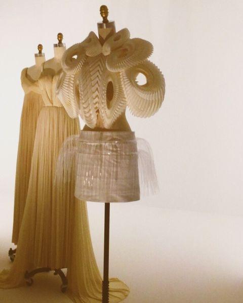Three dresses at Manus x Machina at the Met.