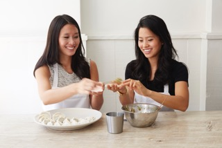 The girls first learned to make dumplings from their mother, Mimi, in elementary school.