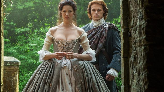 Caitriona Balfe as Claire Randall and Sam Heughan as Jamie Fraser on Outlander.