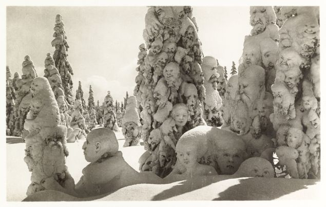 """Postcard of manipulated photograph titled """"Snow ghosts in the forest."""" Switzerland, 1931."""
