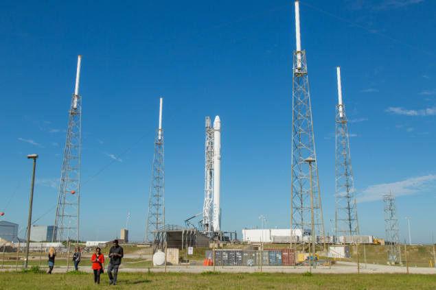 Reporters gather at SpaceX Launch Complex 40 to visit the Falcon 9 rocket.