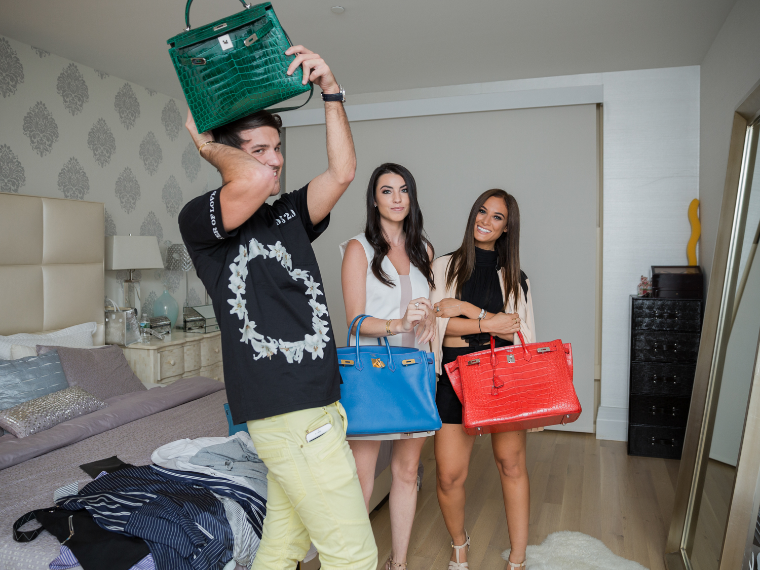 Posing with a few selections from William's Birkin bag collection.