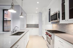 The kitchens feature Caesarstone countertops and shiny new appliances.
