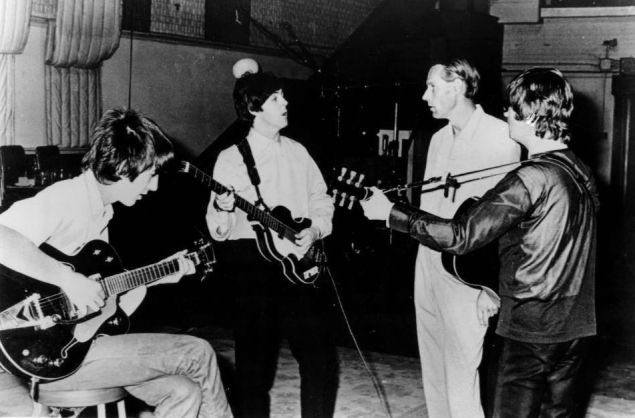 The Beatles with producer George Martin in 1966.