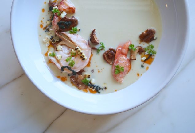 Butter-poached lobster is served with a sweet corn veloute.