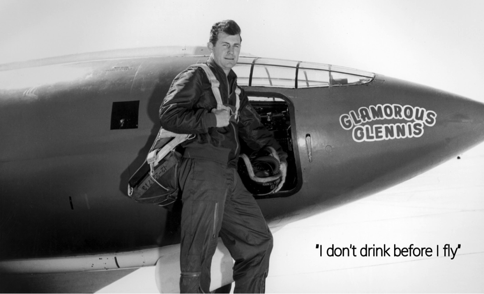 Test pilot Chuck Yeager in front of the Bell X-1 which he used to break the sound barrier.