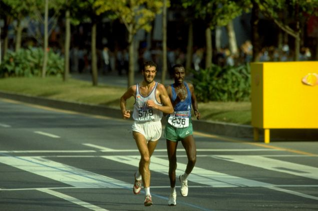 2 Oct 1988: Gelindo Bordin of Italy (left) and Ahmed Saleh of Djibouti in action during the Mens Marathon event of the 1988 Olympic Games in Seoul, South Korea. Bordin won the gold medal and Saleh the bronze.