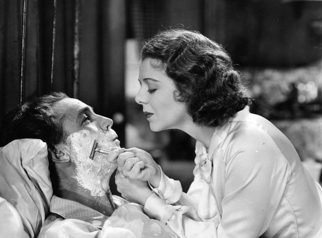 circa 1934: Janet Gaynor (1906 - 1984) is shaving Charles Farrell in the musical film 'Change Of Heart', directed by Albert S Rogell for Republic.
