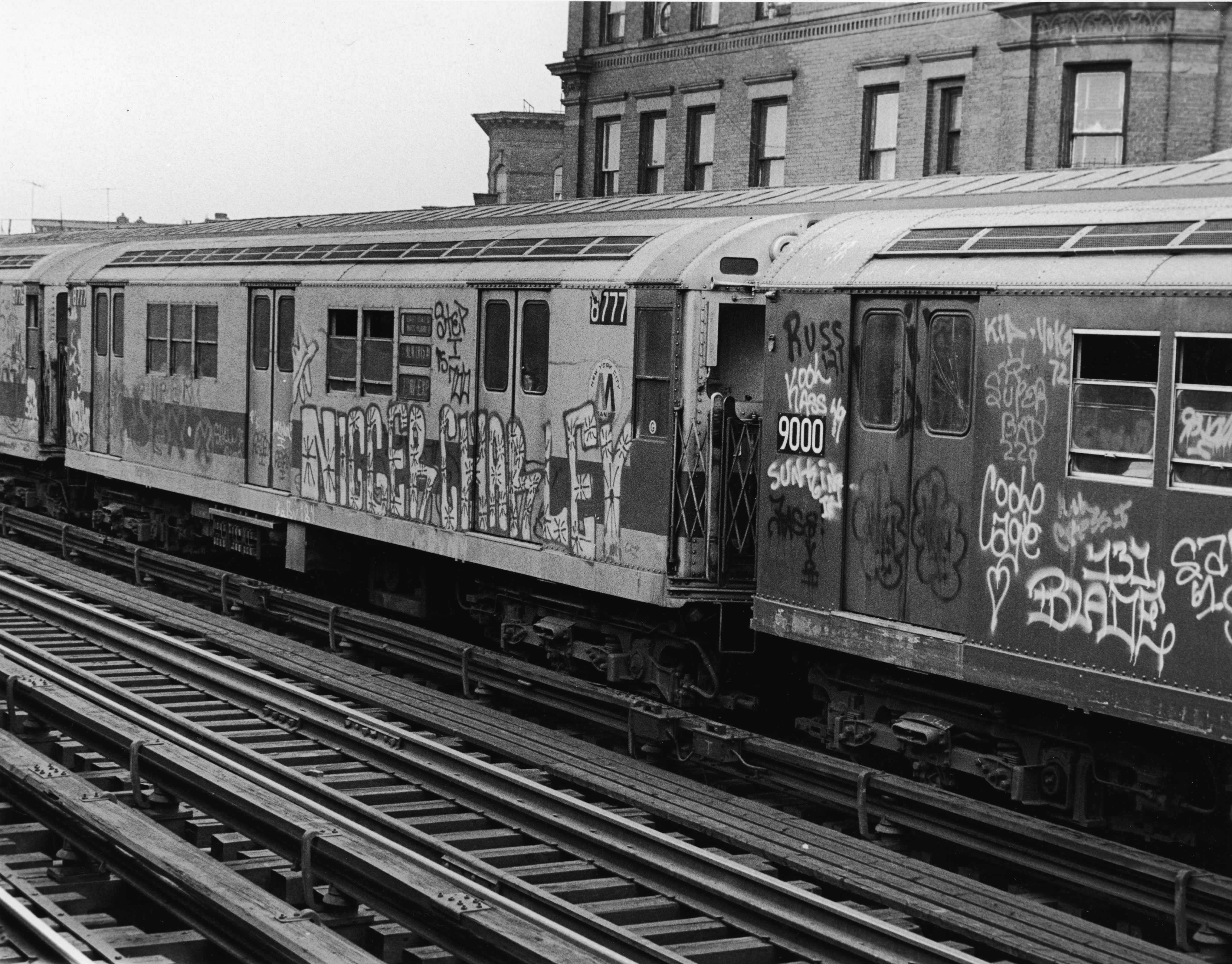 Exterior of subway cars painted with graffiti in the 1970s.
