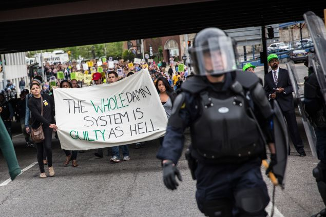 Protesters march through the streets in support of Maryland state attorney Marilyn Mosby's announcement that charges would be filed against Baltimore police officers in the death of Freddie Gray on May 1, 2015 in Baltimore, Maryland.