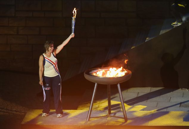Nancy Glickman, whose father, Marty Glickman, was a member of the U.S. Olvmpic team at the Berlin Olympic Games in 1936 but was forced to withdraw because he was Jewish, lights the torch at the official opening ceremony of the European Maccabi Games at the Waldbuehne on July 28, 2015 in Berlin, Germany.