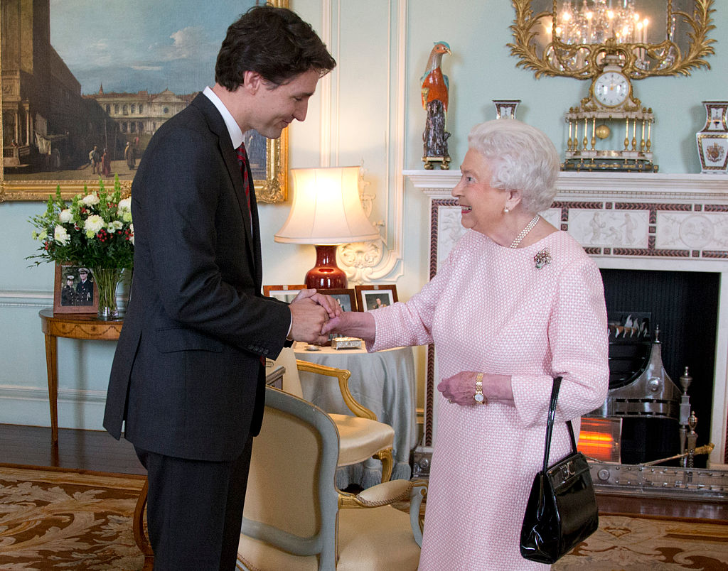 TPrime Minister of Canada Justin Trudeau shake hands with Queen Elizabeth II during a private audience at Buckingham Palace on November 25, 2015 in London, England. This is the first visit of Trudeau in Britain since his election as Canadas Prime Minister.