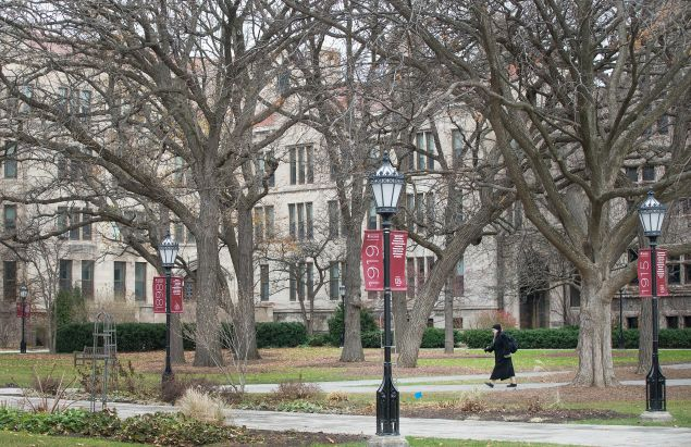 A Pedestrian walks through the Main Quadrangles (Quad) on the Hyde Park Campus of the University of Chicago on November 30, 2015 in Chicago, Illinois.