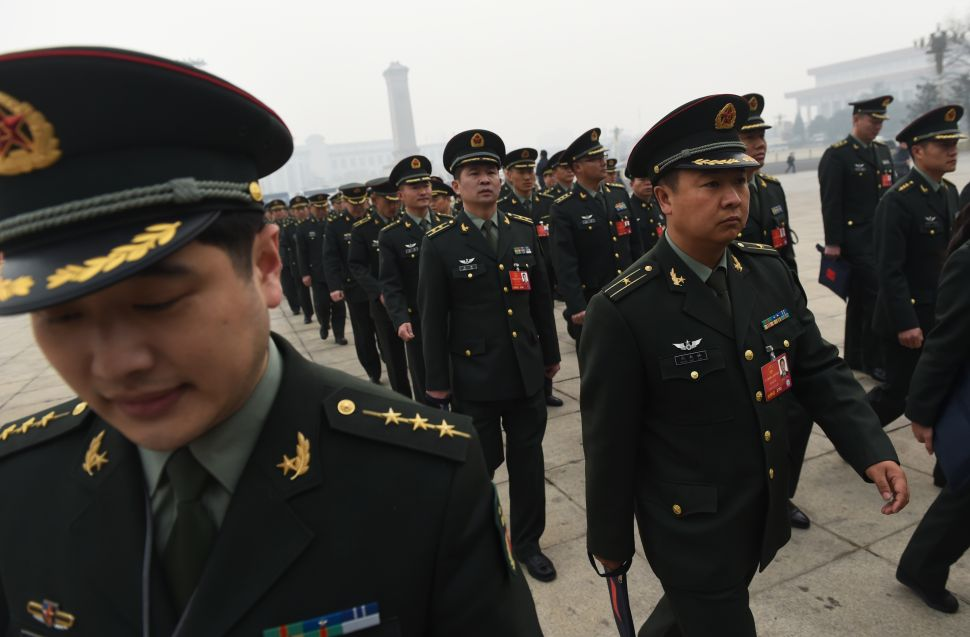 Military delegates arrive for a session of the Chinese People's Political Consultative Conference (CPPCC) in Beijing on March 4