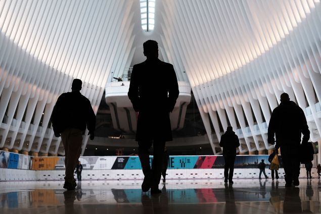 NEW YORK, NY - MARCH 07: Commuters walk through the Oculus of the partially opened World Trade Center Transportation Hub after nearly 12 years of construction on March 7, 2016 in New York City. The grand structure was designed by Spanish architect Santiago Calatrava at a cost of $4 billion in public money, almost $2 billion over budget. The hub offers connections to the PATH train connecting New York City and New Jersey.