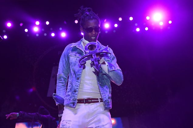Young Thug on stage in a slim-fitting outfit