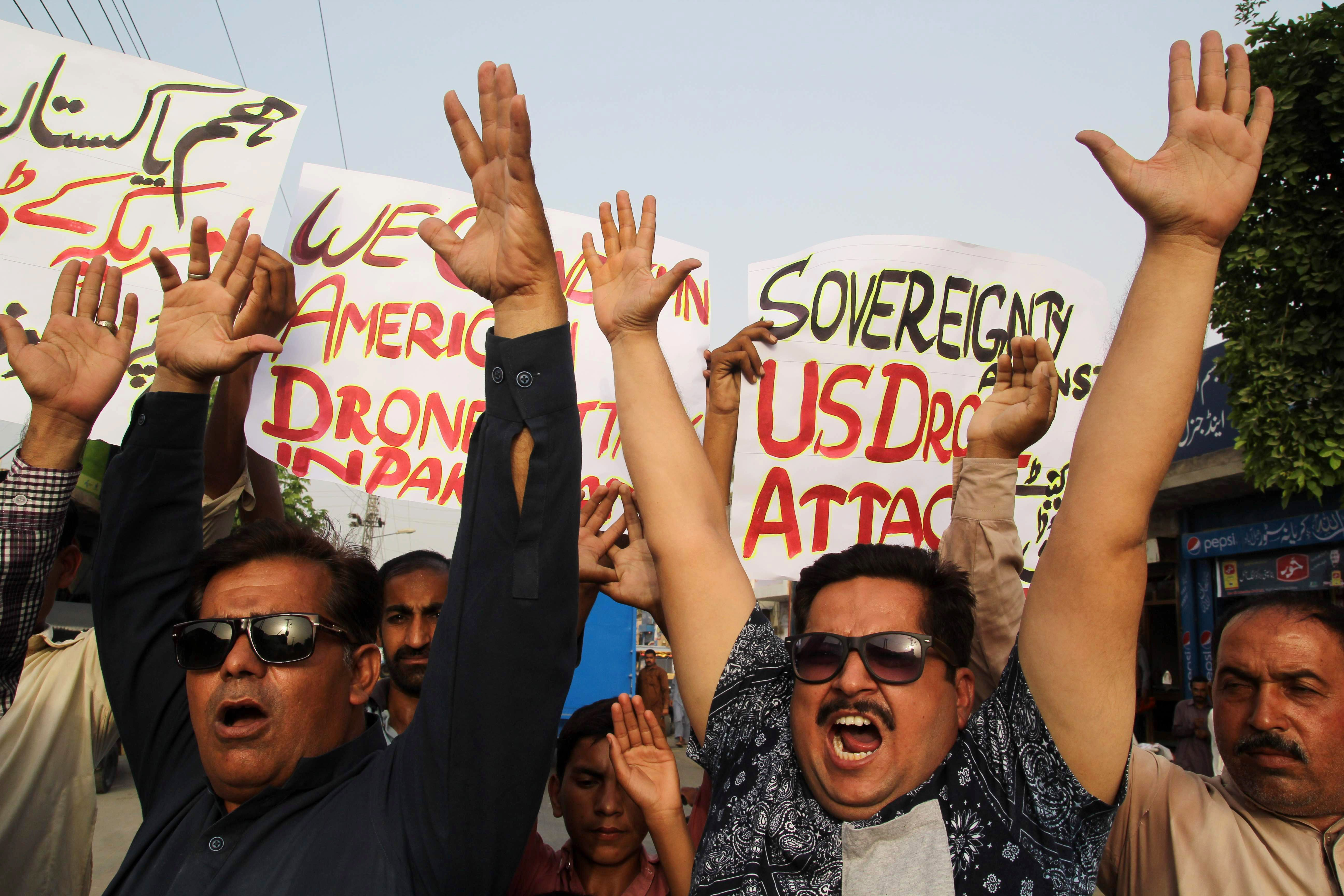 Pakistani civil society activists shout slogans during a demonstration in Multan on May 23, 2016, against a US drone strike in Pakistan's southwestern province of Balochistan.