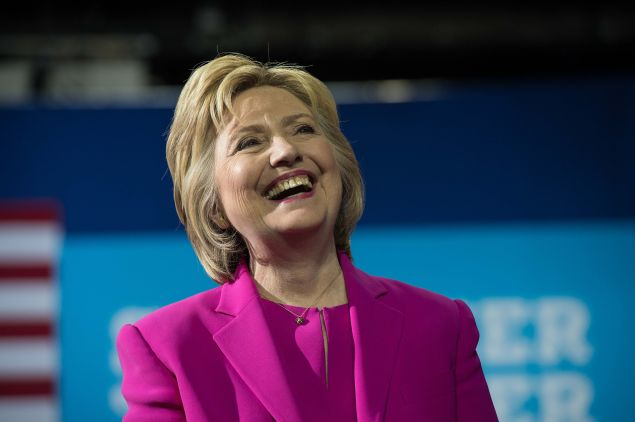 US Democratic presidential candidate Hillary Clinton laughs as President Barack Obama speaks at a campaign event for in Charlotte, North Caro., on July 5