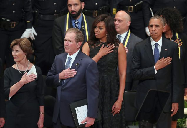 Former first lady Laura Bush, former U.S. President George W. Bush, first lady Michelle Obama and U.S. President Barack Obama join in singing the 'Star-Spangled Banner' during an interfaith memorial service, honoring five slain police officers, at the Morton H. Meyerson Symphony Center on July 12, 2016 in Dallas, Texas.