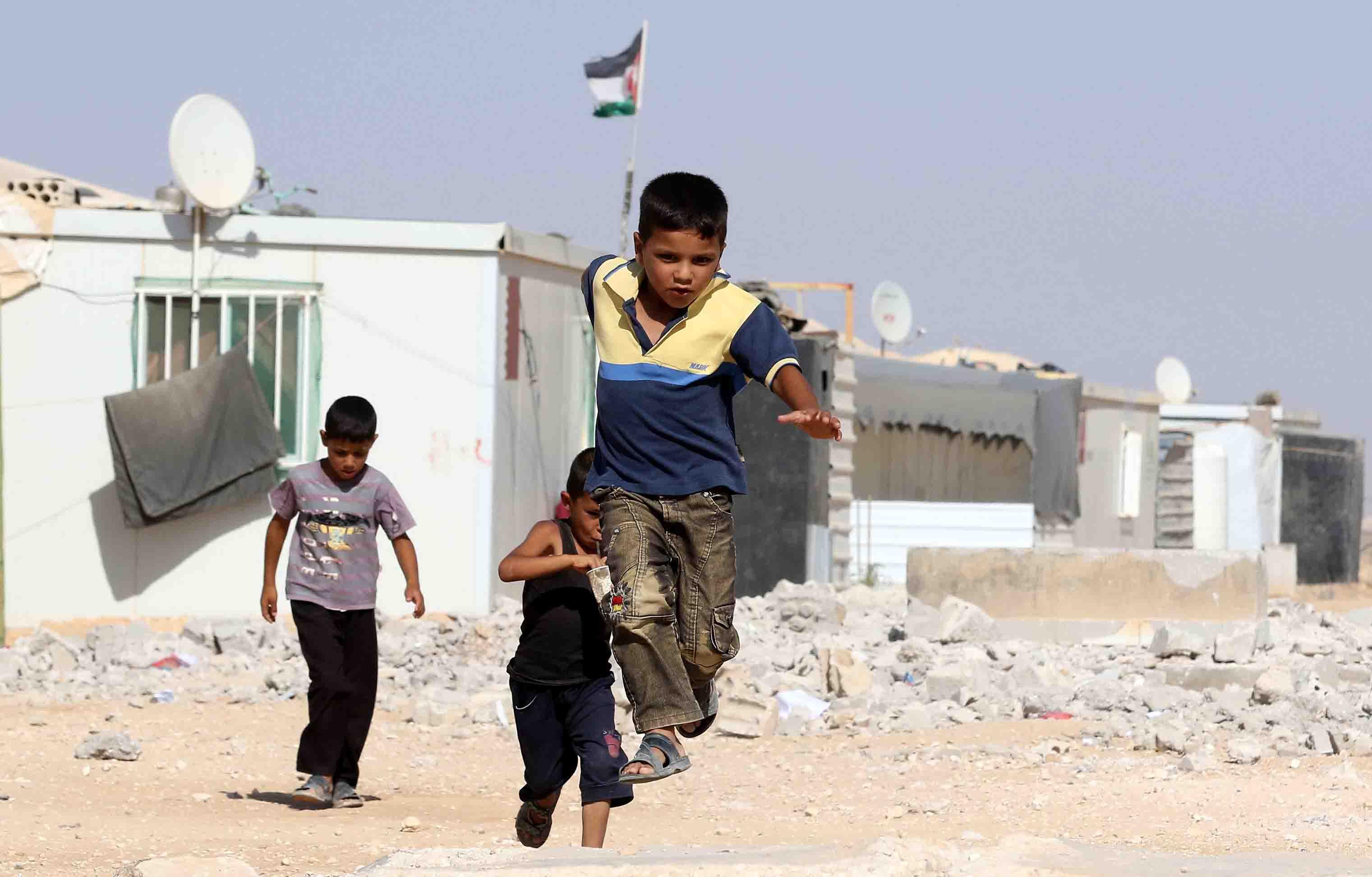 Syrian refugee boys play at the Zaatari refugee camp.