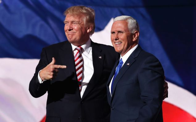 CLEVELAND, OH - JULY 20: Republican presidential candidate Donald Trump stands with Republican vice presidential candidate Mike Pence and acknowledge the crowd on the third day of the Republican National Convention on July 20, 2016 at the Quicken Loans Arena in Cleveland, Ohio.