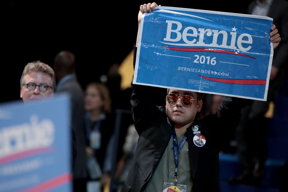 PHILADELPHIA, PA - JULY 25: An attendee holds a sign in support of Sen. Bernie Sanders on the first day of the Democratic National Convention