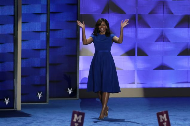 First lady Michelle Obama walks on stage to deliver remarks on the first day of the Democratic National Convention at the Wells Fargo Center, July 25, 2016 in Philadelphia, Pennsylvania.