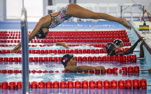 Olympic refugee team swimmer Yusra Mardini dives at the Olympic Aquatics Stadium ahead of the Rio 2016 Olympic Games on July 28, 2016 in Rio de Janeiro, Brazil.