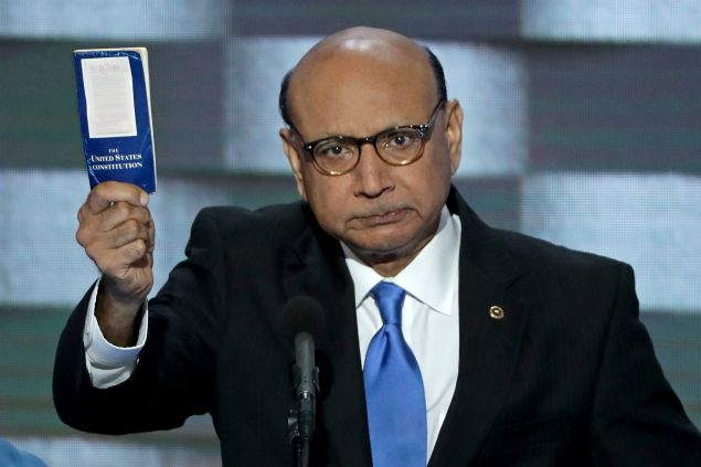 Khizr Khan, father of deceased Muslim U.S. Soldier, holds up a booklet of the US Constitution as he delivers remarks on the fourth day of the Democratic National Convention at the Wells Fargo Center, July 28, 2016 in Philadelphia, Pennsylvania.