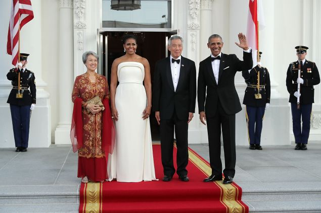 Ho Ching, first lady Michelle Obama, Prime Minister Lee Hsien Loong of Singapore and U.S. President Barack Obama pose for photographs in the North Portico of the White House August 2, 2016 in Washington, DC.