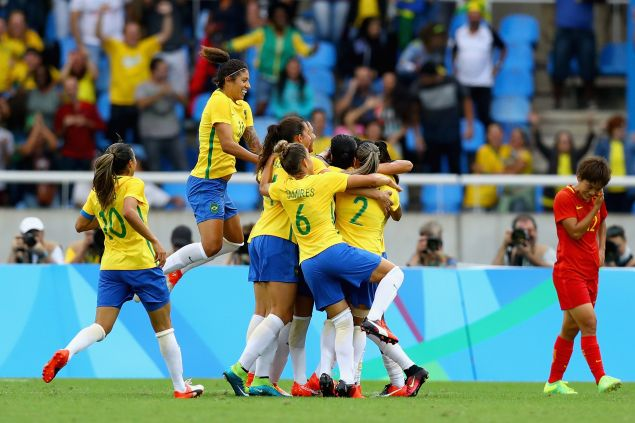 Brazil players celebrate as Monica scores their first goal during the Women's Group E first round match between Brazil and China PR during the Rio 2016 Olympic Games at the Olympic Stadium on August 3, 2016.