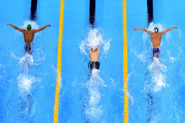 Chad le Clos, left, and Michael Phelps, right, in the close race