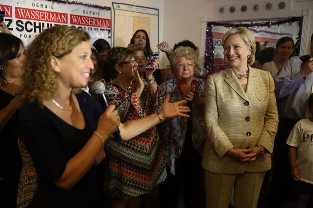 Debbie Wasserman Schultz (D-FL) introduces Democratic presidential nominee Hillary Clinton as she stops by her campaign headquarters on August 9, 2016 in Davie, Florida. Hillary continues to campaign to become the next President of the United States.