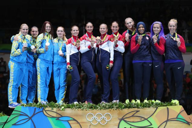 Silver medalists Ukraine, gold medalists Russia and bronze medalists United States celebrate on the podium during the Women's Sabre Team gold medal match between Russia and Ukraine on Day 8 of the Rio 2016 Olympic Games at Carioca Arena 3 on August 13, 2016 in Rio de Janeiro, Brazil.