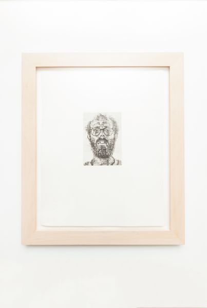A Chuck Close painting, which was a gift from a client