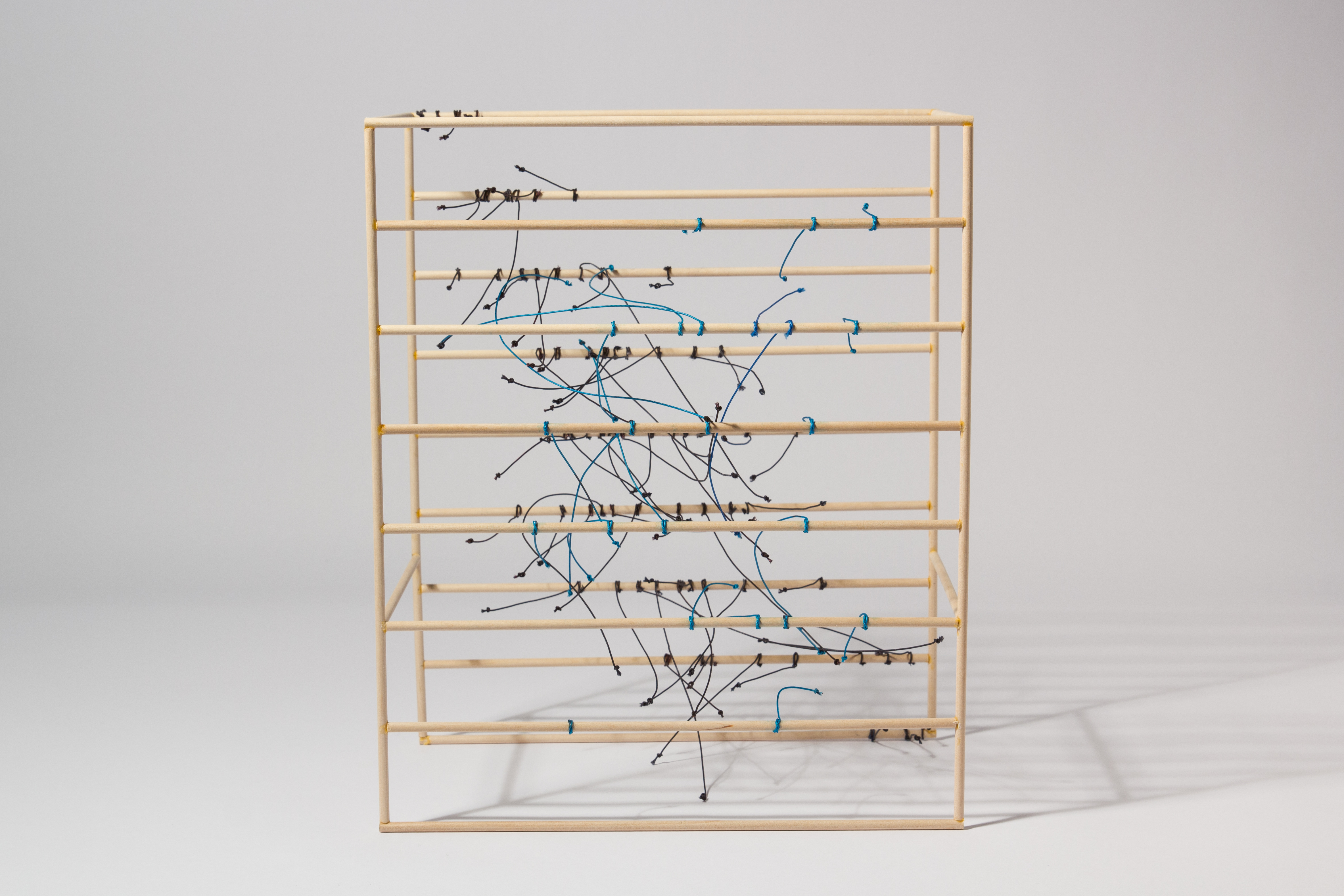 Richard Ibghy & Marilou Lemmens, Average Years of Schooling and Income Gini Coefficient, 2016, Wood and string, 11 × 13 × 63/4 in. (27.94 × 33.02 × 17.14 cm).