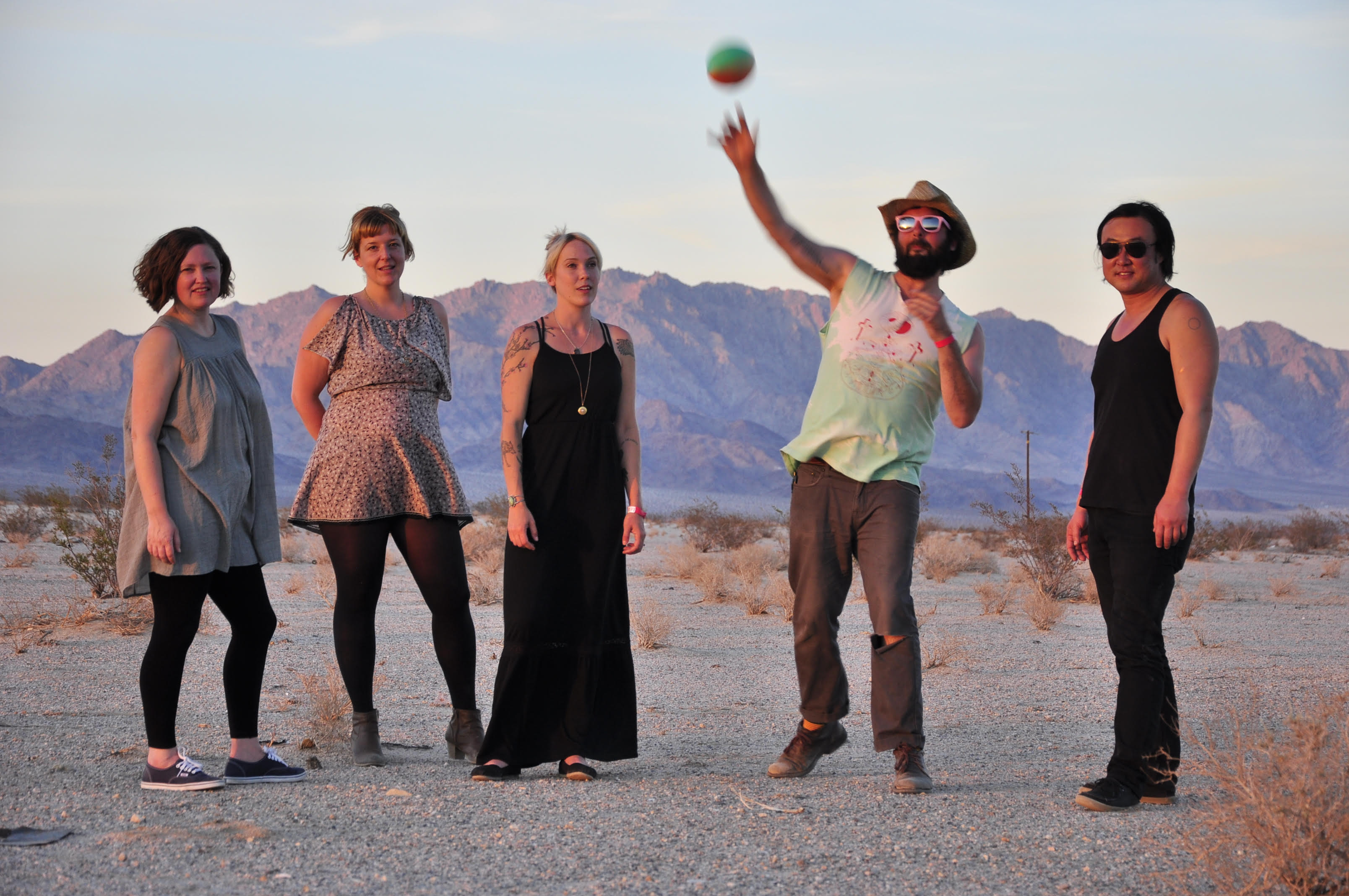 Tim Cohen (second from right) in the desert with friends.