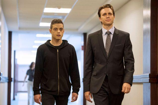 Rami Malek as Elliot Alderson and Martin Wallstrom as Tyrell Wellick
