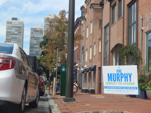 Signs for Murphy, the first candidate to announce his campaign, crop up in Center City