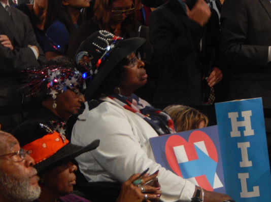 One delegate watches as Chelsea Clinton speaks before introducing her mother