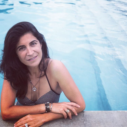 Designer Catherine Zadeh posed in her own jewels while posing in the pool.