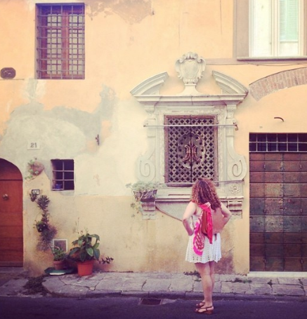 Designer Dana Arbib exploring Italy on one of her travels.