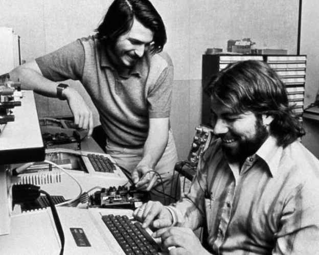 Steve jobs and Steve Wozniak with their first Apple personal computer.